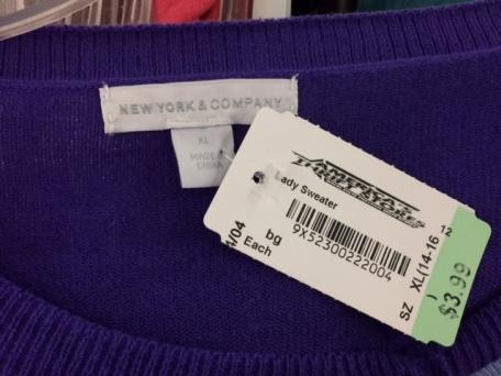 Purple sweater tag