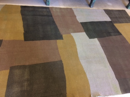 Unique floor coverings are one use for used Eileen Fisher garments.