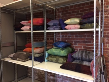 Pillows of former Eileen Fisher clothing, felted into new fabric, are sold at ABC Home and other outlets.